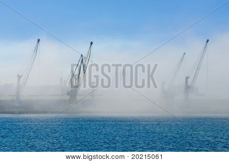 Dockyard Cranes In Mist