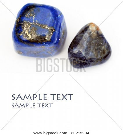 a couple of beautiful precious stones against white background