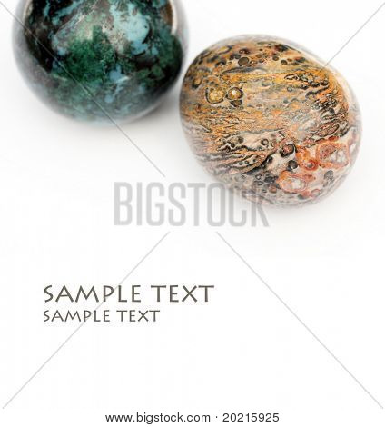 two beautiful precious stones against white background