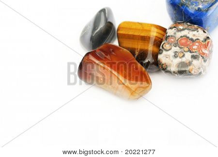 a collection of beautiful precious stones against white background