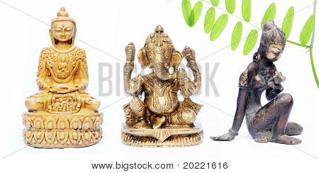 lovely figures of buddha, ganesh and an indian girl against white background