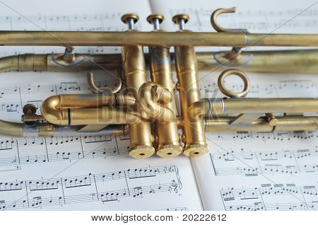 beautiful shiny trumpet on sheet music