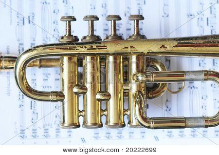 beautiful shiny trumpet on sheet music