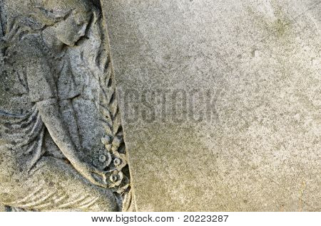 stone statue in a cemetery / graveyard in london england