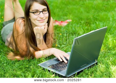 Girl Using Laptop Outdoors