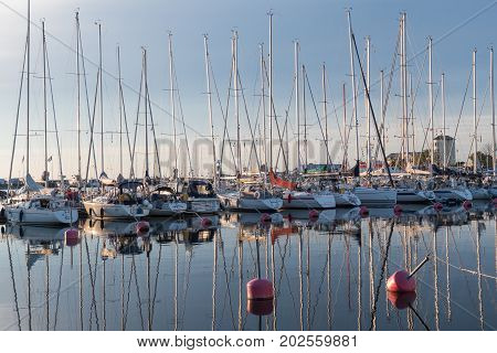 BORGHOLM, SWEDEN - JULY 22: Yachts in Borgholm harbor a calm evening at the swedish island Oland in the Baltic Sea. Photo on  July 22, 2017 in  Borgholm, Sweden .