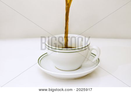 Pouring Coffee On A Cup