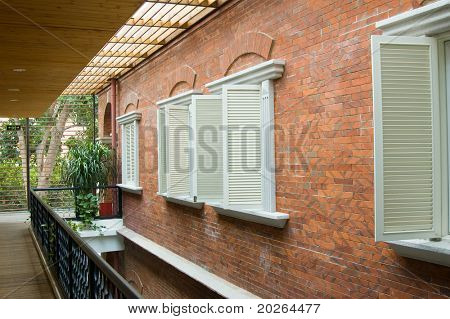 Patio with old style shutters and brick