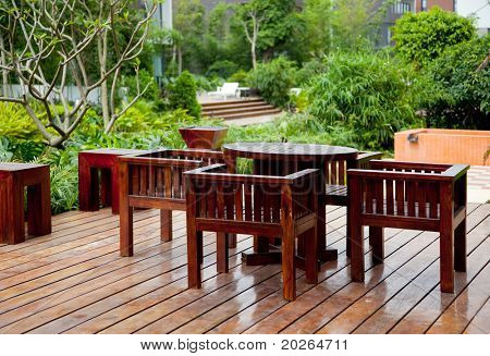 House patio with wooden table and chairs