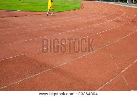 Man running on the track lane