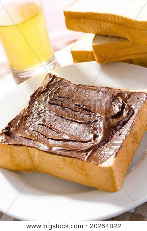 Toast with chocolate sauce on the table