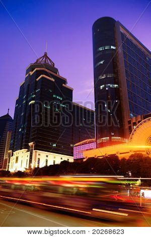 Nightscape downtown fuzhou with blurred bus trailing