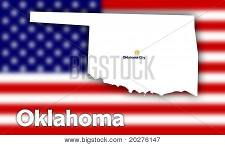 Oklahoma state contour with Capital City against blurred USA flag