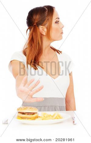 serious woman don't want to eat junk food. isolated on white background