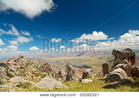 Andes scenic landscape beautiful blue sky white clouds big rocks granite rock formations Bolivia altiplano south america