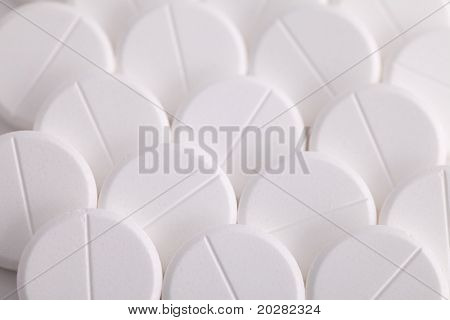 round pills paracetamol or aspirin painkiller remedy works against headache fever flu and pain a white pill medicine and the cure for illness a drug medicine