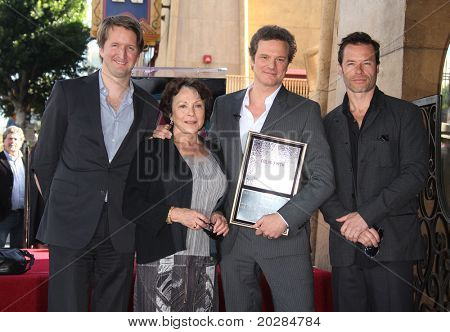 HOLLYWOOD - JAN 13: Unidentified guests with Colin Firth & Guy Pearce (right) as actor Colin Firth receives his star on the Hollywood Walk of Fame on January 13, 2011 in Hollywood, CA
