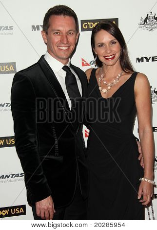 HOLLYWOOD - JAN 22:  Rove McManus & guest arrives at the 2011 G'Day USA Los Angeles Gala  on January 22, 2011 in Hollywood, CA