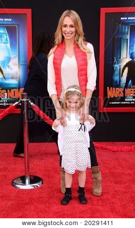 "LOS ANGELES - MAR 06:  Taylor Armstrong & Kennedy arrive at the ""Mars Needs Moms"" World Premiere  on March 06, 2011 in Hollywood, CA"