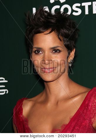 LOS ANGELES - FEB 22:  Halle Berry arrives to the 13th Annual Costume Designers Guild Awards  on February 22, 2011 in Hollywood, CA