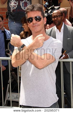"LOS ANGELES - MAY 08:  Simon Cowel arrives to the ""X-Factor"" LA Auditions  on May 08,2011 in Los Angeles, CA"