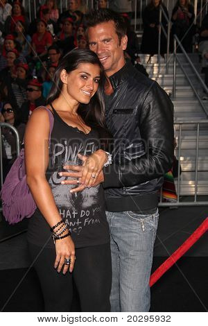 """LOS ANGELES - MAY 07:  Lorenzo Lamas & Wife arrives to the """"Pirates of the Caribbean: On Stranger Tides"""" World Premiere  on May 7, 2011 in Anaheim, CA"""