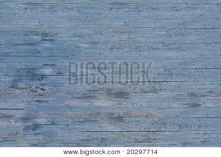 Old wooden blue painted surface. The paint is faded and cracked, you can see small cracks. Uniform illumination and a wide tonal range, sharpness is not increased. For any designer's use.