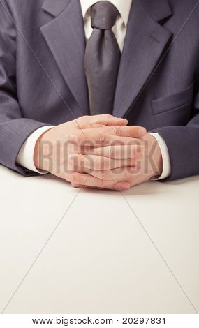 Man in business suit sitting at the table