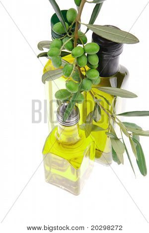 green raw olives with gold oil on white background