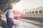 Enjoying Travel. Young Pretty Woman Traveling Classic Train For Travel In Summer. Travel Concept. poster