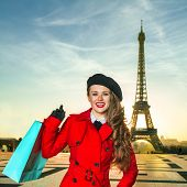 Traveller Woman Against Eiffel Tower In Paris With Shopping Bag poster