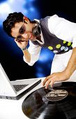 stock photo of disc jockey  - disc jockey in a nighctlub having fun with the music - JPG