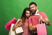 Shopping And Fashion Concept. Bearded Man Holds Shopping Bag poster