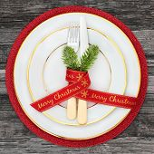 Christmas dinner table place setting with plates, merry christmas ribbon with napkin, cutlery and fi poster