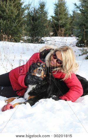Woman And Dog In Winter
