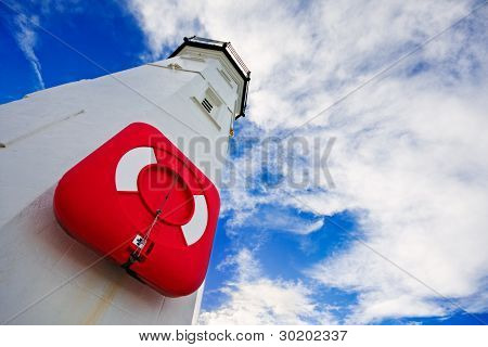 Lighthouse With Red Life Preserver