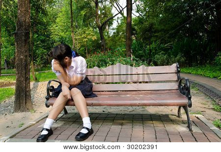 Thai High-schoolgirl Crying Alone On The Bench