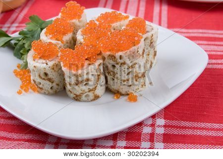 Rolls From Pancakes With Red Caviar On A Plate