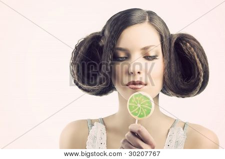Vintage Girl With Lollipop. She Looks The Lollipop