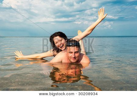 Young Pair In The Sea