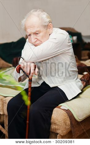 Unhappy Old Man With Cane