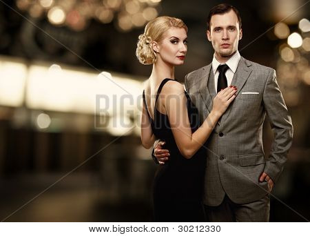 Retro couple over blurred background.