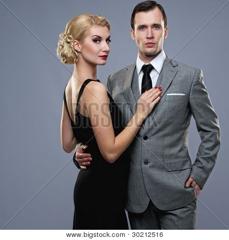 Retro couple on grey background.