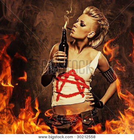 Punk girl smoking a cigarette over fire background.