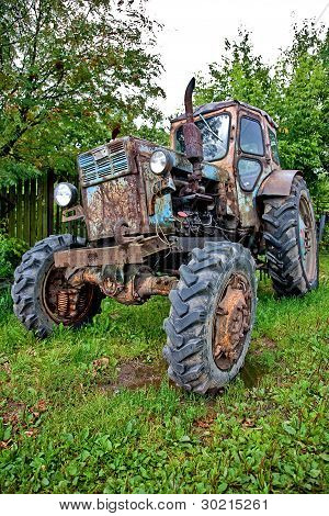 Old Tractor Against Trees