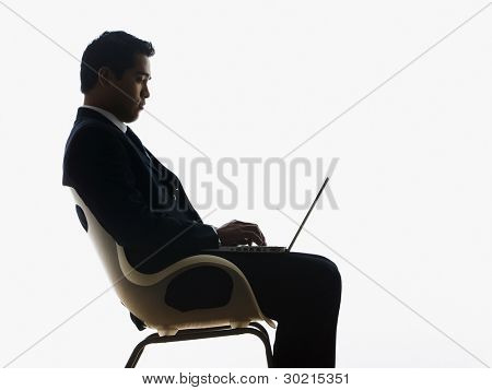 Side view of businessman using a laptop