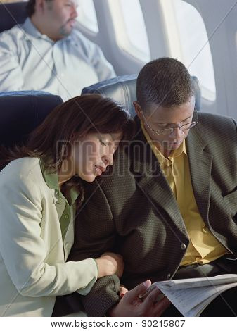 Mature couple relaxing on airplane