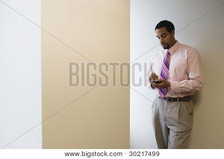 Businessman using hand held device