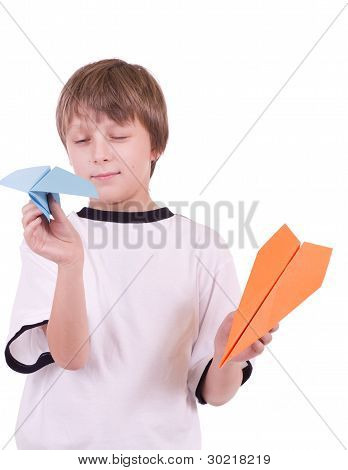 Little beautiful boy with paper airplanes