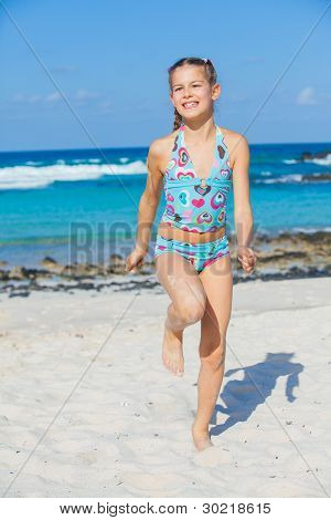 Adorable girl on the beach